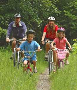 Family riding bikes - Virginia Creeper Trail.